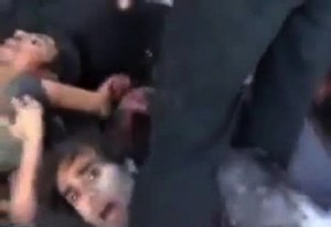 "An image grab taken from a video dated on November 1, 2012 and uploaded on YouTube shows alleged Syrian government forces lying on the ground before being executed by rebel fighters at the Hamisho checkpoint near Saraqeb. The video shows armed rebels kicking and executing their prisoners after they forced them to lie down in the destroyed structure of the checkpoint. AFP PHOTO/YOUTUBE == RESTRICTED TO EDITORIAL USE - MANDATORY CREDIT ""AFP PHOTO/YOUTUBE"" - NO MARKETING NO ADVERTISING CAMPAIGNS - DISTRIBUTED AS A SERVICE TO CLIENTS - AFP IS USING PICTURES FROM ALTERNATIVE SOURCES AS IT WAS NOT AUTHORISED TO COVER THIS EVENT, THEREFORE IT IS NOT RESPONSIBLE FOR ANY DIGITAL ALTERATIONS TO THE PICTURE'S EDITORIAL CONTENT, DATE AND LOCATION WHICH CANNOT BE INDEPENDENTLY VERIFIED =="